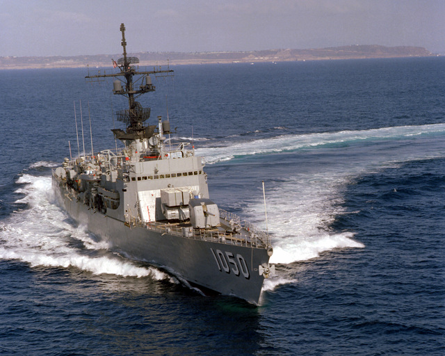 An aerial starboard bow view of the frigate USS ALBERT DAVID (FF-1050) underway near San Diego, Calif
