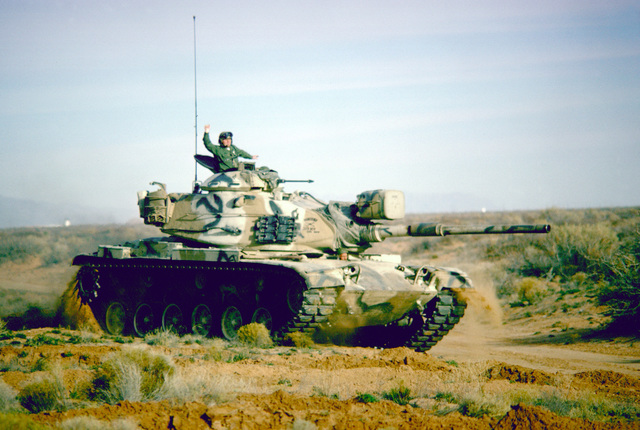 An M-60 main battle tank moves out during a training exercise