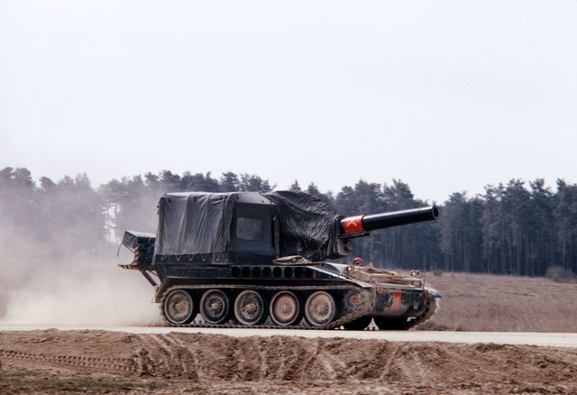 An M110 203 mm (8-inch) self-propelled howitzer moves out during a combat training exercise