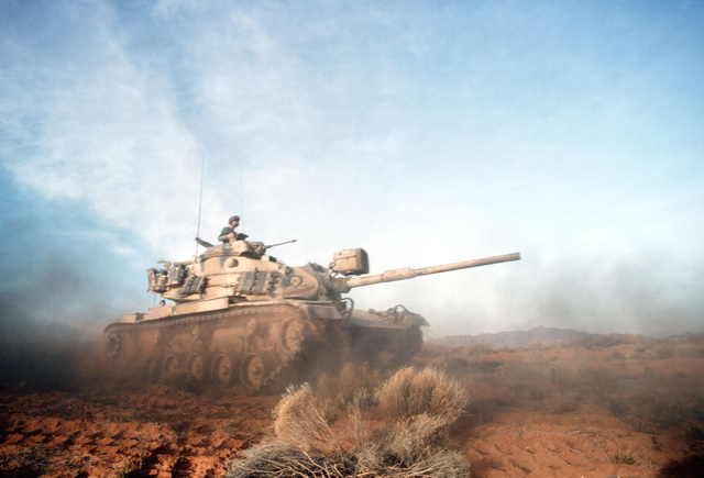 An M60 main battle tank moves out during a combat training exercise