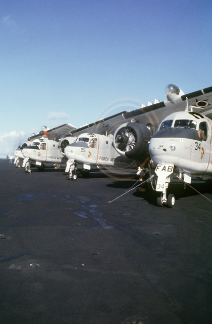 Brazilian S-2G Tracker aircraft starts their engines during flight operations aboard the aircraft carrier USS AMERICA (CV 66) while underway off the coast of Rio de Janiero