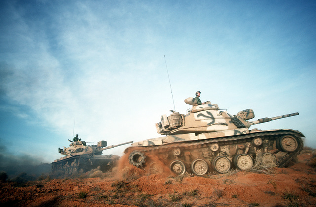 M-60 main battle tanks move out during a field training exercise