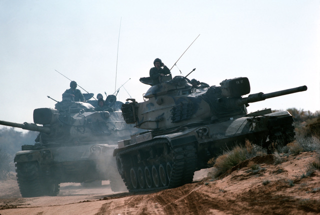 M60 main battle tanks move out during a combat training exercise