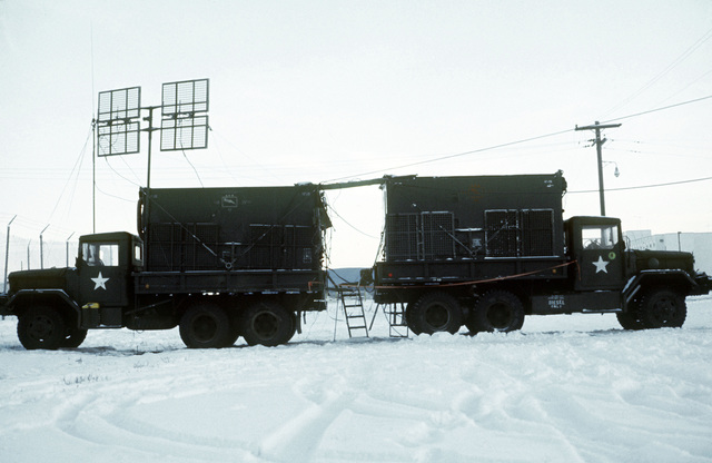 A view of two truck-mounted shelters housing MRC-69 radio terminal sets during arctic training exercise Jack Frost '77