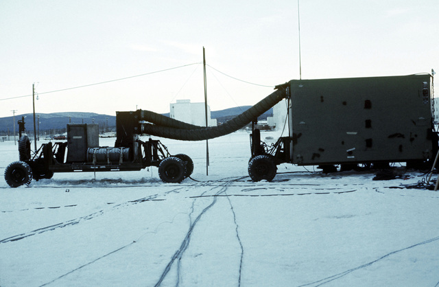 An exterior view of TSC-62 technical control central van and utility trailer in use during arctic training Exercise JACK FROST 77