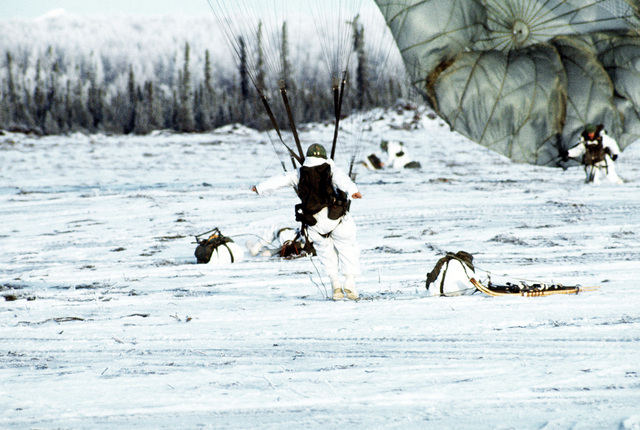 Paratroopers land in the drop zone during the Arctic training exercise Jack Frost '77