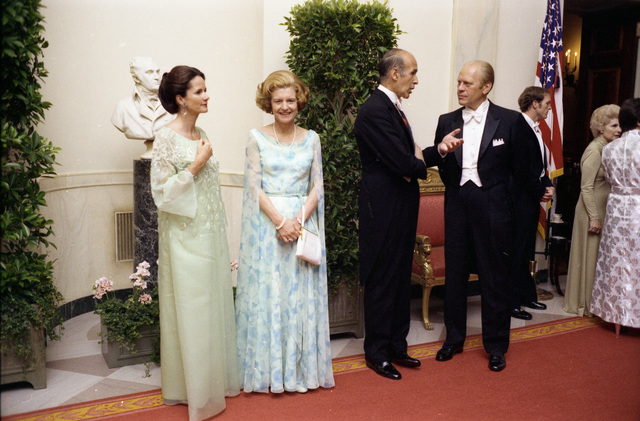Anne-Aymone Giscard d'Estaing, First Lady Betty Ford, President Valery Giscard d'Estaing of France, and President Gerald R. Ford Talking at the Close of a Receiving Line at a State Dinner
