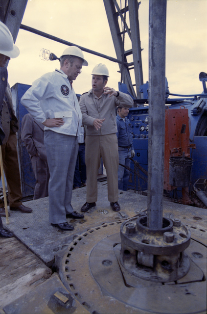 Commander Roger Martin Giving President Gerald R. Ford and Others a Tour of the Drilling Site at the Elk Hills Naval Petroleum Reserve in Elk Hills, California