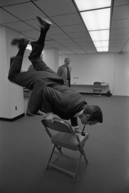 Donald Rumsfeld Does a Handstand on a Chair