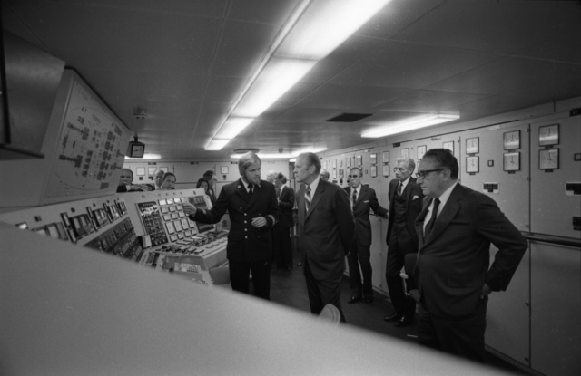 Electrical Engineer Jan Ahlfors Giving President Gerald R. Ford and Secretary of State Henry Kissinger a Briefing in the Control Room during Their Tour of the Icebreaker URHO in Helsinki, Finland