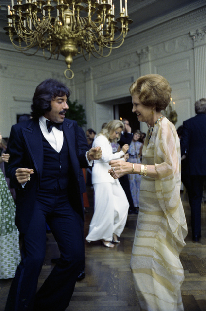 First Lady Betty Ford and Singer Tony Orlando Dancing in the East Room Following a State Dinner Honoring the President of Finland