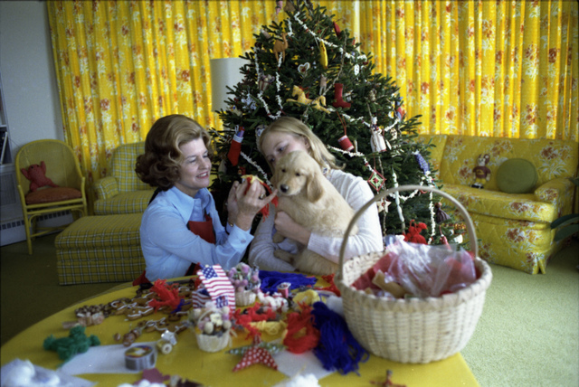 First Lady Betty Ford and Susan Ford Playing with Their Puppy Misty during a Photo Shoot for Parade Magazine in the White House Solarium