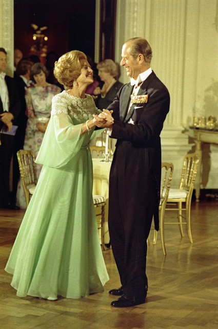 First Lady Betty Ford Dancing with Prince Philip of Great Britain in the State Dining Room during a State Dinner Honoring Queen Elizabeth II and Prince Philip