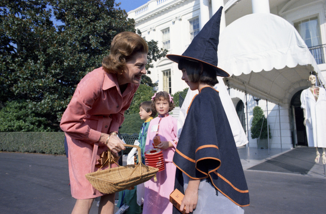 First Lady Betty Ford Greeting Children Participating in Trick or Treat for UNICEF outside the White House