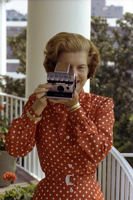 First Lady Betty Ford Takes a Photograph using a Polaroid SX-70 Camera