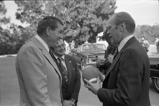 Former Baltimore Colts Quarterback Johnny Unitas Presenting a Signed Football to President Gerald R. Ford at the Sheraton Orlando Jetport Inn in Orlando, Florida