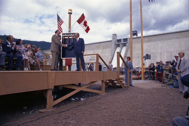 President Gerald R. Ford and Canadian Minister of Energy, Mines, and Resources Donald S. Macdonald Shaking Hands at the Dedication Ceremony for Libby Dam in Libby, Montana