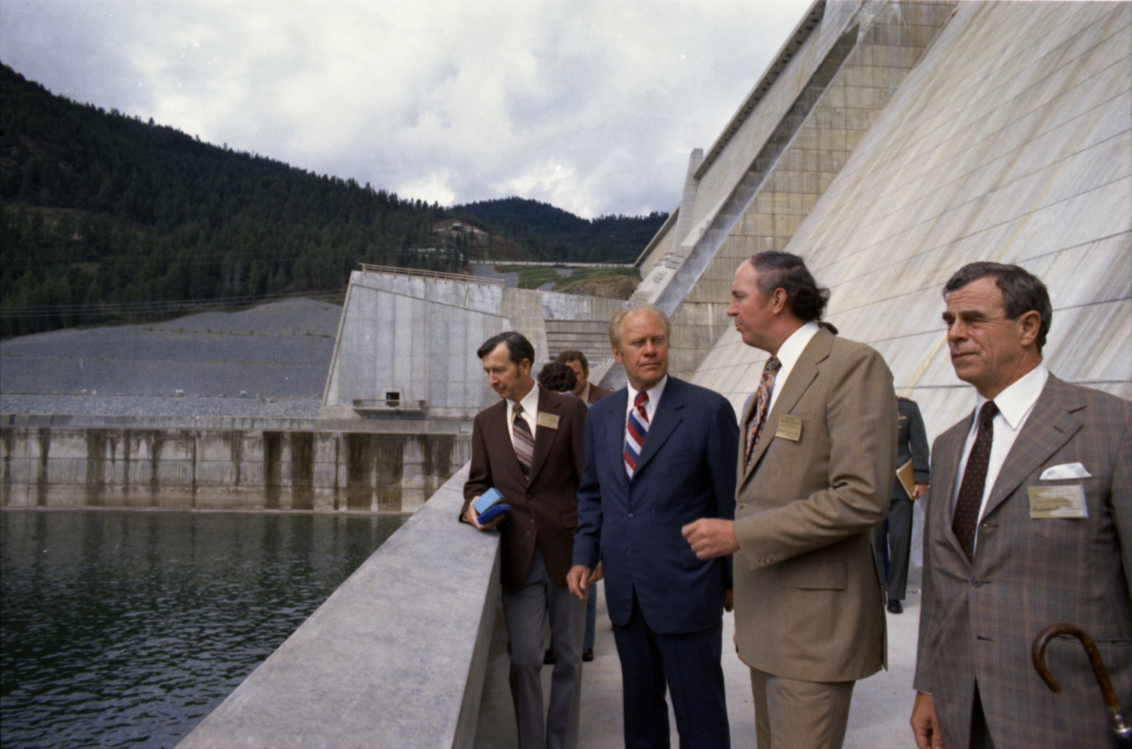 President Gerald R. Ford and Canadian Minister of Energy, Mines, and Resources Donald S. Macdonald With Others on the Observation Deck at Libby Dam in Libby, Montana