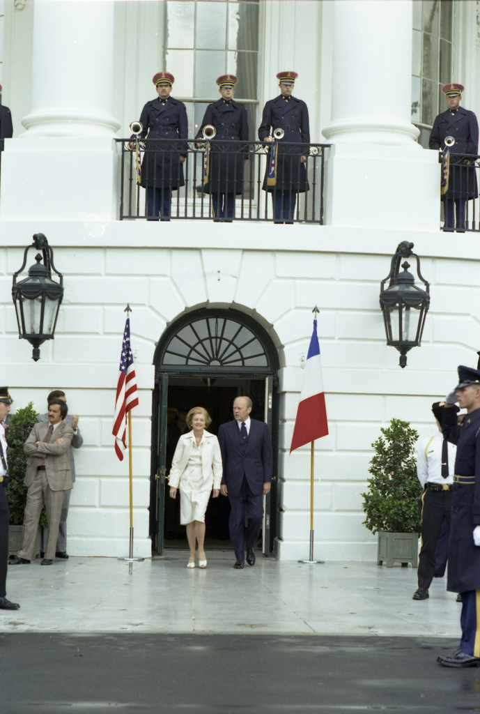 President Gerald R. Ford and First Lady Betty Ford Exiting the South Portico of the White House Prior to an Arrival Ceremony for the President of France