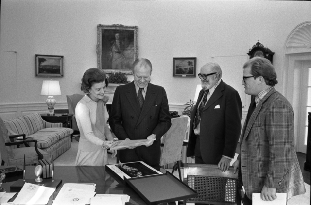 President Gerald R. Ford and First Lady Betty Ford Looking at Photographs in the Oval Office with Ansel Adams and William Turnage
