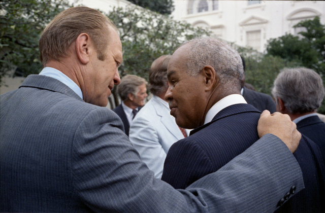 President Gerald R. Ford and Roy Wilkins in the Rose Garden Following the Signing Ceremony for H.R. 6219, Extending the Voting Rights Act of 1965