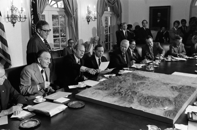 President Gerald R. Ford and Secretary of State Henry Kissinger Review a Map of the Sinai Peninsula during a Meeting with Bipartisan Congressional Leaders  in the Cabinet Room