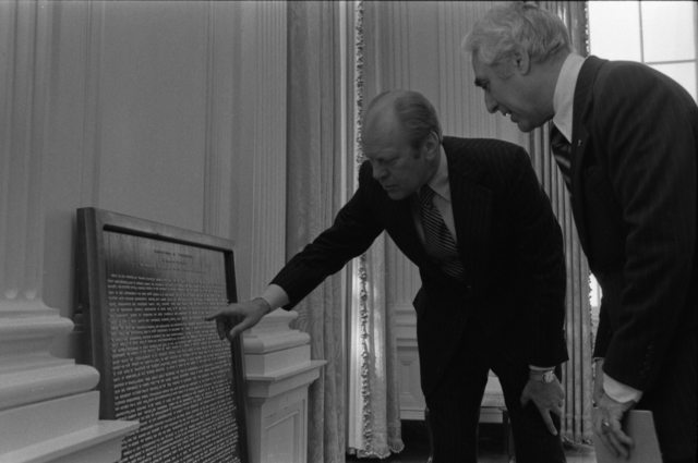 President Gerald R. Ford and White House Coordinator of Bicentennial Affairs Milt Mitler Viewing a Plaque of the Declaration of Independence Written Out in Alphabet Noodles