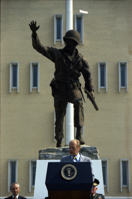 """President Gerald R. Ford Delivering Remarks in Front of Infantry Hall and the """"Follow Me"""" Statue at Fort Benning, Georgia, in Celebration of the 200th Anniversary of the U.S. Army and U.S. Army Infantry"""
