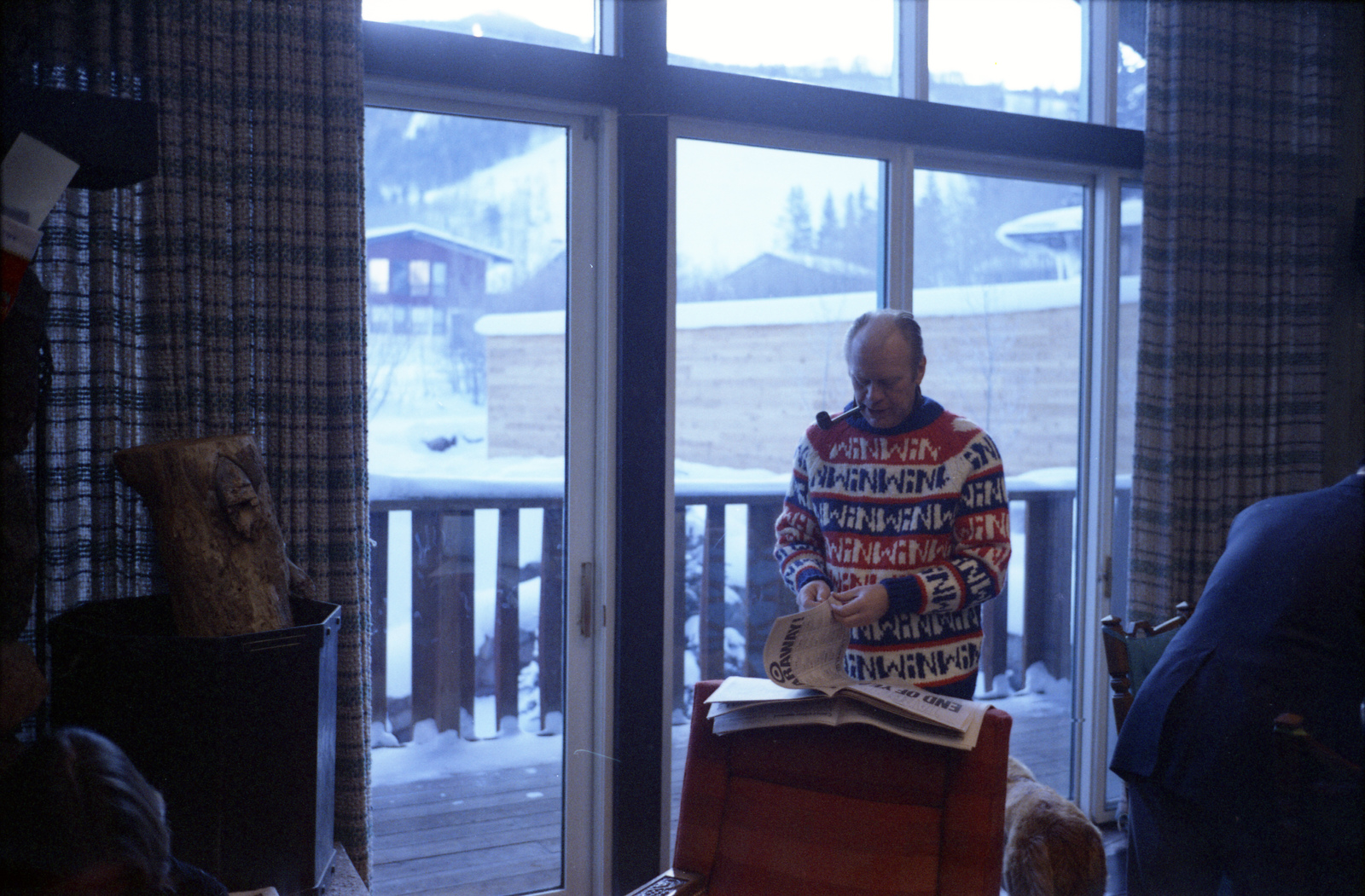 President Gerald R. Ford Reading a Newspaper during His Christmas Vacation Trip to Vail, Colorado