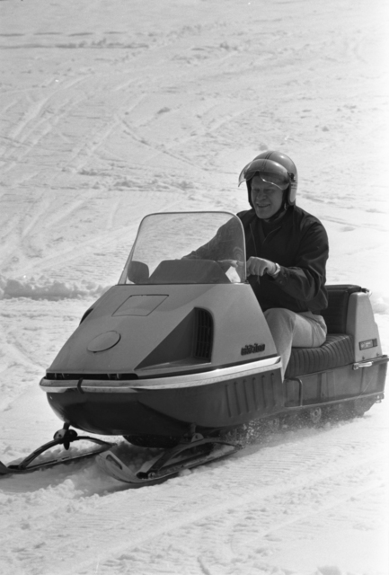 President Gerald R. Ford Riding a Snowmobile at Camp David