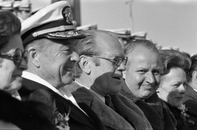 President Gerald R. Ford, Secretary of the Navy J. William Middendorf, and the Naval Academy Superintendent Vice Admiral William Mack Watch the First Half of the 75th Army-Navy Football Game at John F. Kennedy Stadium