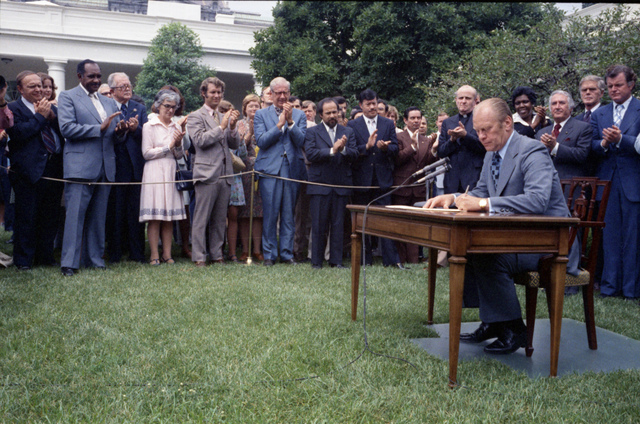 President Gerald R. Ford Signing H.R. 6219, Extending the Voting Rights Act of 1965, at a Ceremony in the Rose Garden