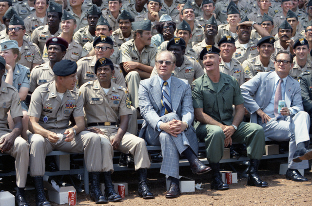 President Gerald R. Ford Sitting with Troops and Watching a Demonstration at Fort Benning's Victory Pond during His Visit on the 200th Anniversary of the U.S. Army and U.S. Army Infantry