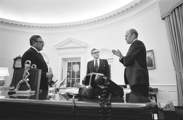 President Gerald R. Ford Speaking with Henry Kissinger and Vice President Nelson Rockefeller in the Oval Office Prior to a National Security Council Meeting to Discuss the Situation in South Vietnam