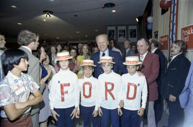 President Gerald R. Ford Standing with Children Wearing F-O-R-D Shirts at a Reception for Texas State President Ford Committee Staff and Volunteers in San Antonio, Texas