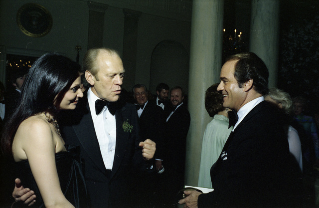 President Gerald R. Ford Talking with Princess Diane von Furstenberg and Fashion Designer Luis Estevez during a State Dinner Honoring the Prince Minister of Ireland