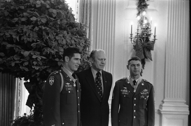 President Gerald R. Ford With Medal of Honor Recipients Army Warrant Officer Louis R. Rocco and Army Staff Sergeant Jon R. Cavaiani Following the Presentation Ceremony in the East Room