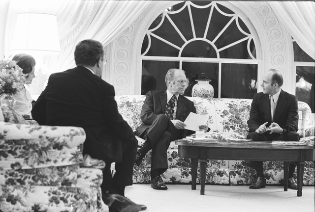 Secretary of State Henry A. Kissinger and National Security Adviser Brent Scowcroft Visiting the West Sitting Room to Apprise President Gerald R. Ford, and First Lady Betty Ford, on the Progress of the Evacuation of Americans from Saigon