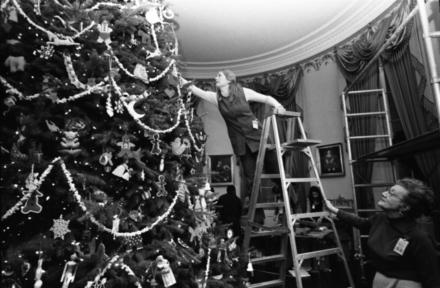 Staff from the Abby Aldrich Rockefeller Folk Art Collection Decorating the White House Blue Room Christmas Tree