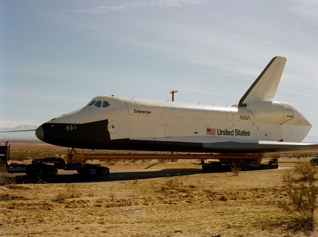 A left side view of the Space Shuttle Orbiter Enterprise as it arrives at the base