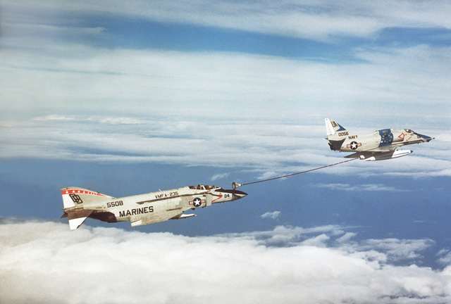 A right side view of an A-4 Skyhawk aircraft, from Fleet Composite Squadron 1 (VC-1), as it refuels an F-4J Phantom II aircraft from Marine Corps Fighter Squadron 235 (VMFA-235)