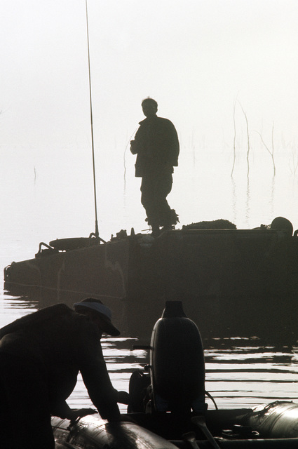 SPEC. 4 Alfred Martinez, mechanic from the 17th Engineers, 1ST Cavalry, stands on top of his partially submerged armored personnel carrier (APC) waiting to be rescued during the joint services Operation Gallant Crew '77