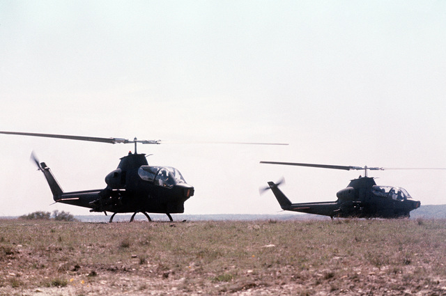 Two AH-1 Cobra helicopters stand by ready for take-off during the joint services Operation Gallant Crew '77