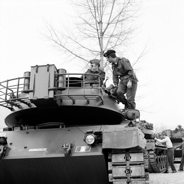 Colonel Jimmy G. Martin, Aviano Air Base Commander, inspects one of five new M-60 main battle tanks that have been assigned to the Italian 132nd Manin Tank Brigade