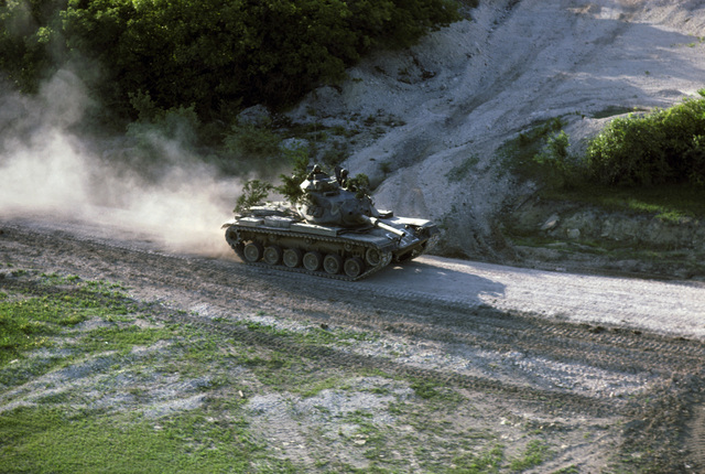 An M60 main battle tank on maneuvers during a field training exercise