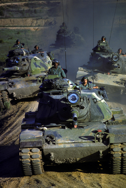 M60 main battle tanks on maneuvers during a field training exercise