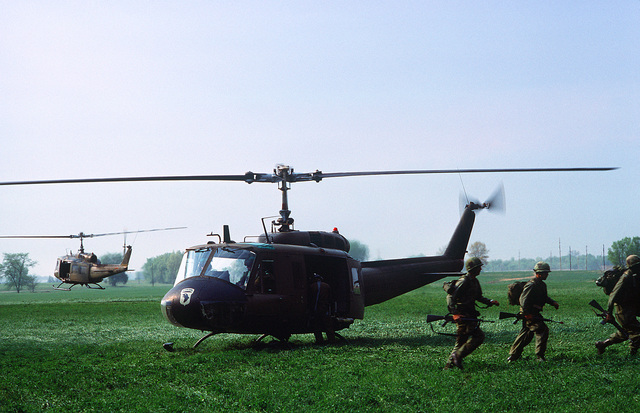 Members of the 101st Airborne Division deploy from a UH-1 Iroquois helicopter during an exercise