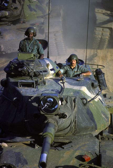 US Army tank crewmen an M60 main battle tank during a field training exercise