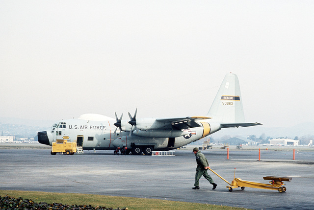 A left side view of an RC-130 Hercules aircraft on the flightline prior to flying a practice rescue mission off the coast of California. The aircraft is assigned to the 129th Aerospace Rescue and Recovery Group of the Air National Guard