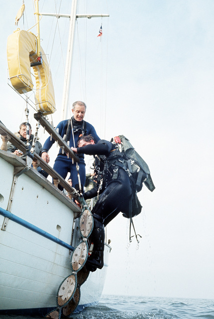 A pararescueman from the 129th Aerospace Rescue and Recovery Group of the Air National Guard climbs into a boat off the coast of California. He parachuted into the water near the boat during a practice rescue mission